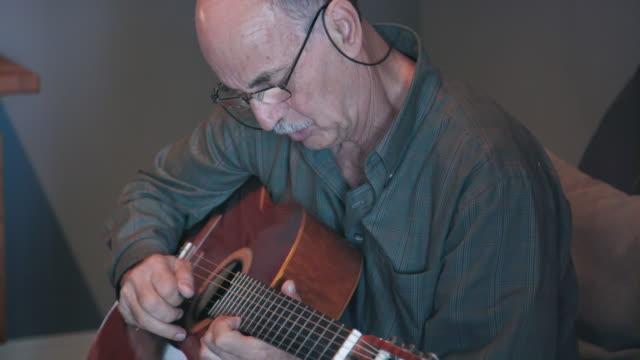 Senior Southern European Man Plays Guitar