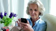 Senior texting sofa    CM LI RO