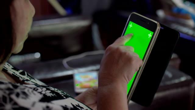 CU : Senior Using Green Screen Tablet