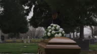 senior woman at a funeral