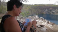 Senior Woman Coloring a lagoon.