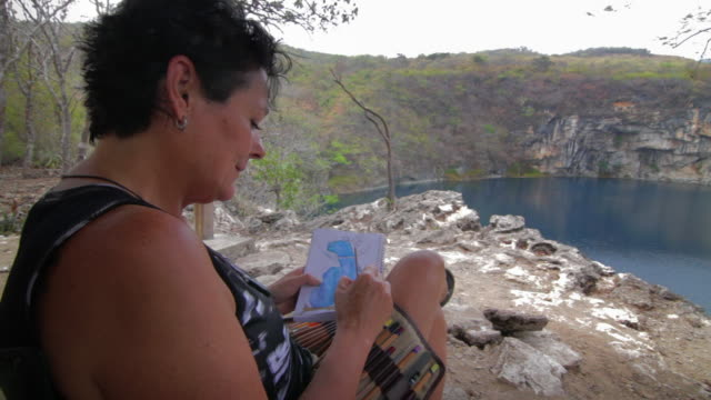 Senior Woman Coloring a lagoon.