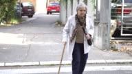 Senior woman crossing the street