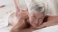 HD: Senior Woman Enjoying Back Massage