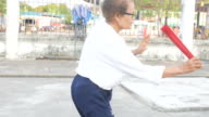 senior woman exercise Chinese hand fan dance at car park