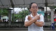 senior woman exercise Tai-Chi dance at car park