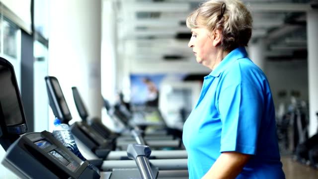 Senior woman exercising on a treadmill.