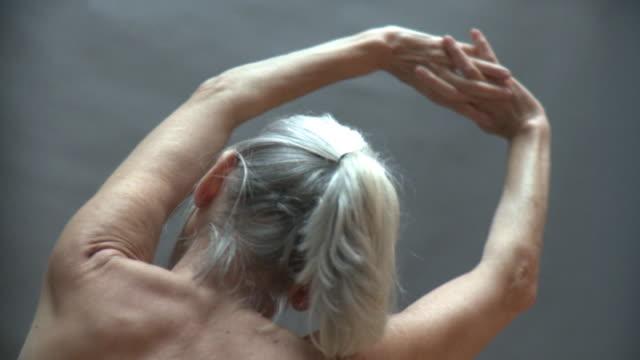 CU Senior woman exercising with arms raised, New York City, New York, USA