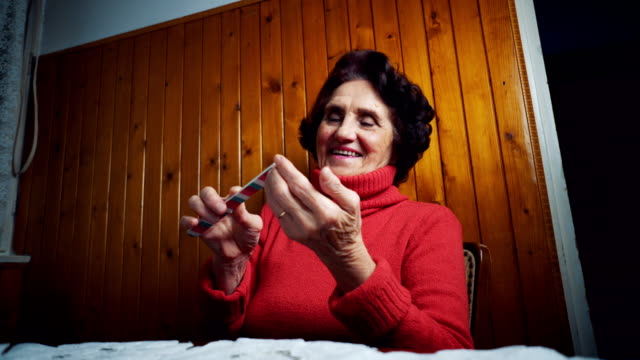 Senior woman files her nails