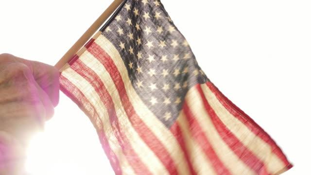 Senior Woman Holding US Flag