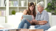 HD DOLLY: Senior Woman Learning To Use Tablet