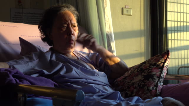senior woman patient coughing