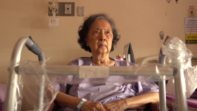 senior woman patient healing her knee surgical wounds