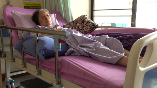senior woman patient lying in sickbed at hospital
