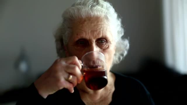Senior woman portrait drinking tea