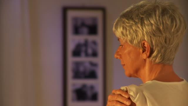 HD: Senior Woman Reminiscing