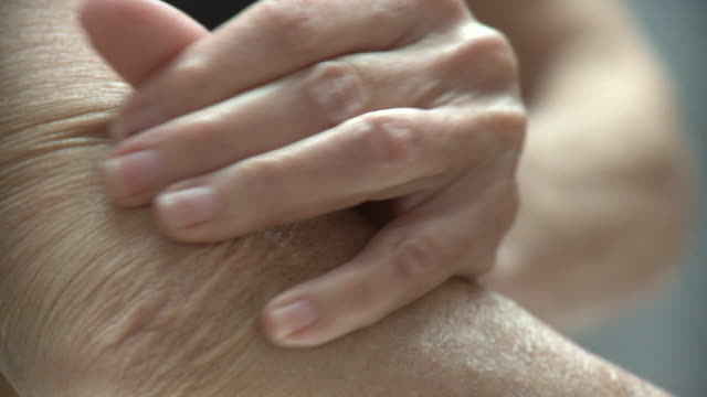 ECU Senior woman rubbing elbow, New York City, New York, USA