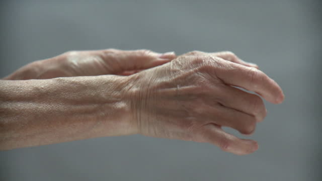 CU Senior woman rubbing wrist and thumb, New York City, New York, USA