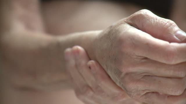 ECU R/F Senior woman rubbing wrist, New York City, New York, USA