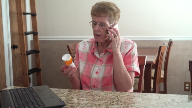 Senior Woman Searching Medicine