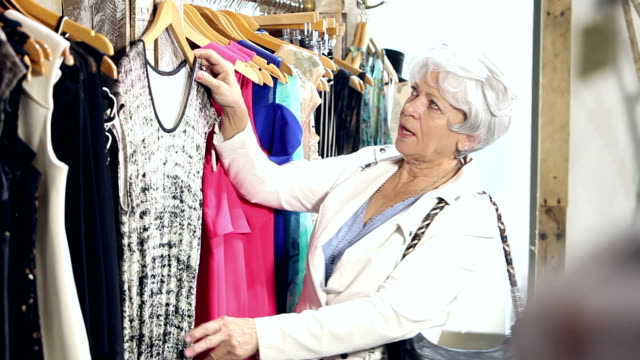 Senior woman shopping for clothing