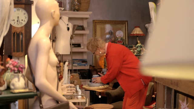 Senior woman shopping in antiques store