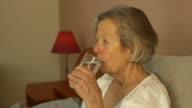 Senior Woman Takes Medicine