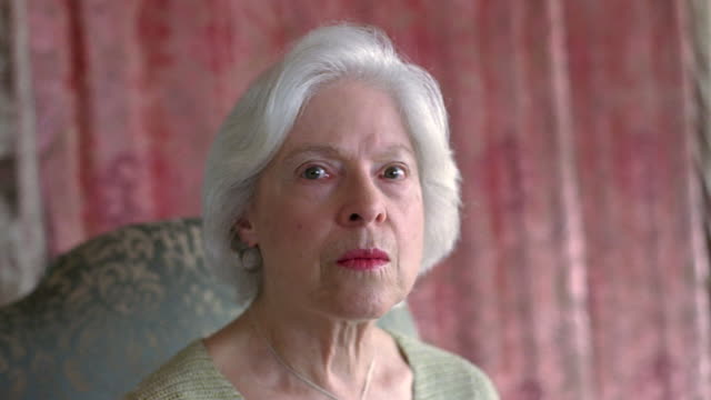 CU Senior woman turning head and looking serious / Washington State, USA