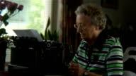 Senior woman typing (720p)