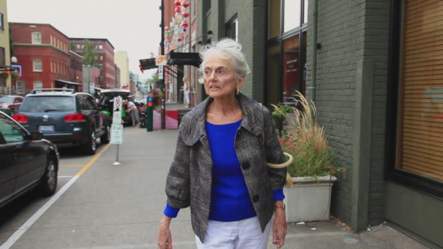 MS POV Senior woman walking through shopping neighborhood / Portland, Oregon, USA