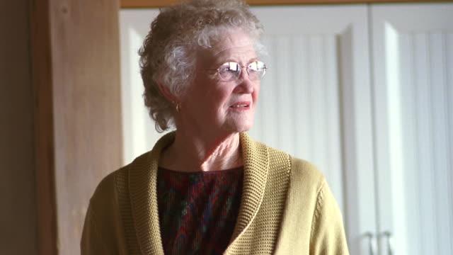 MS Senior woman wearing eye glasses and looking around room / Washington State, USA