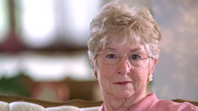 CU Senior woman wearing eye glasses and smiling / Washington State, USA