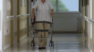 HD: Senior Woman With Wheeled Walker