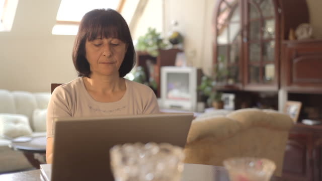 Senior woman working on computer