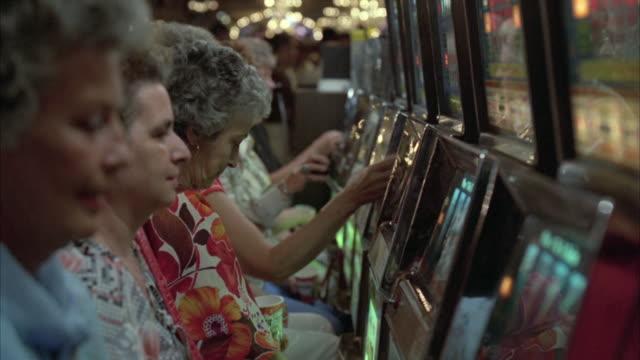 CU Senior women playing Slot Machines