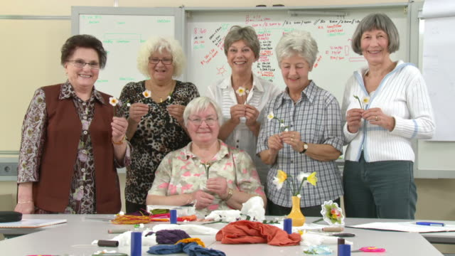 HD DOLLY: Senior Women Posing During Craft Class
