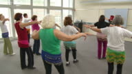 HD DOLLY: Senior Women Practicing Belly Dance