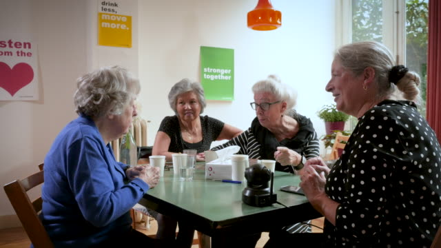 Senior women support group gathering and learning about safety