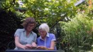 Seniors at Home: watching holiday video