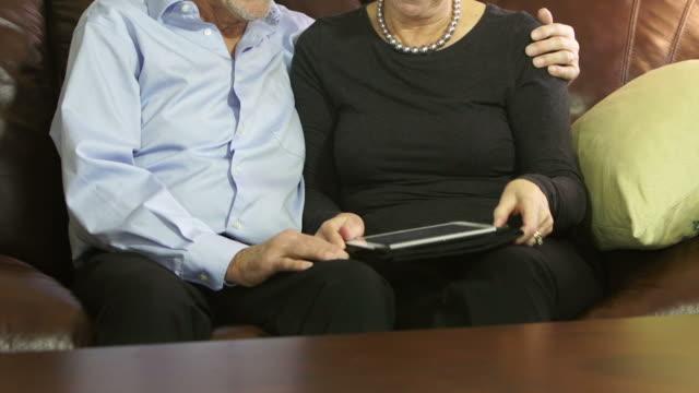 Seniors enjoy a digital tablet using it proficiently