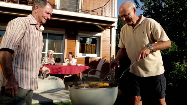 seniors garden grilling in summer