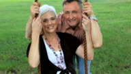 Seniors in Park on Swing