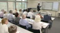 HD: Seniors Participating Financial Planning Seminar