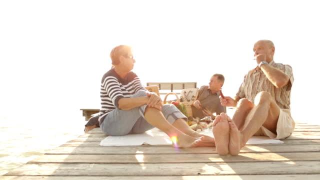 seniors picnic on jetty