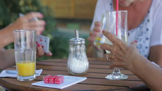 Seniors playing cards, handheld shot