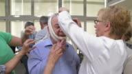 HD: Seniors Practicing Head Bandaging