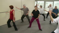 HD: Seniors Practicing Tai Chi