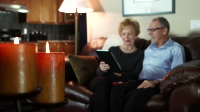 Seniors research on digital tablet, rack focus