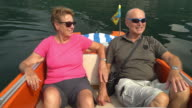 Seniors Taking on the World, very happy couple in boat on lake