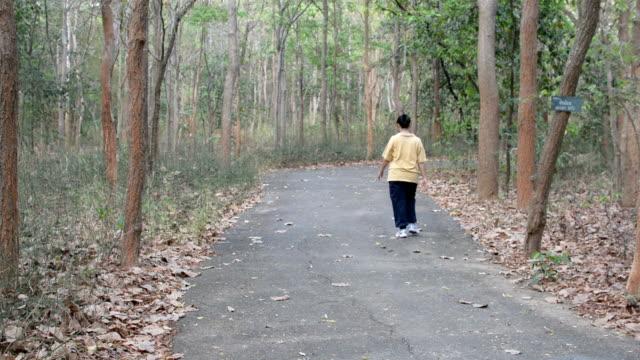 Seniors walking In Park